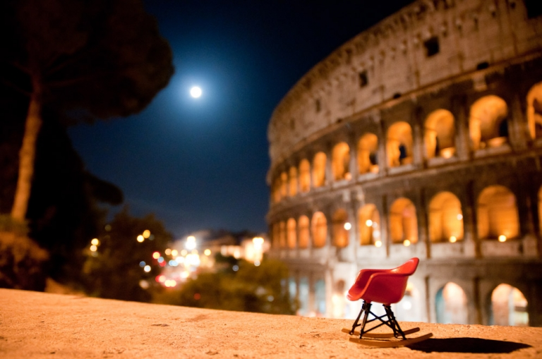 Miniature Eames RAR rocker in front of the Colosseum, Rome, Italy